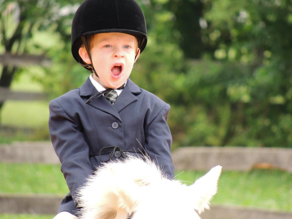 Karen Kennedys grandson Connor 5 yawning at a very early morning lead line class on his pony Spice